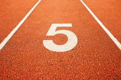 Number five on running track Royalty Free Stock Image
