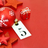 Number five on tag and Christmas ornamets Stock Photography