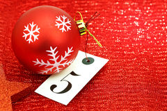 Number five on tag and Christmas ornamets Royalty Free Stock Photos