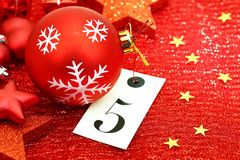 Number five on tag and Christmas ornamets Royalty Free Stock Image