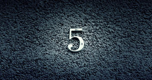 Number five on the wall of a house Royalty Free Stock Photography