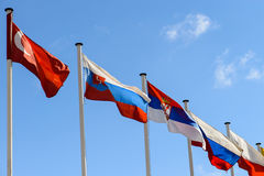 A number of flags of states against the blue sky Stock Photo