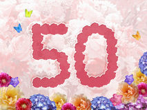Number 50, flower background. Number 50 on flowers, pastel background with flowers, design for jubilee or birthday Royalty Free Stock Photo