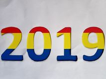 Number 2019 with foamy in colors blue, yellow and red with white background. Backdrop for announcements of new year, celebration and event, date, time, design stock photography