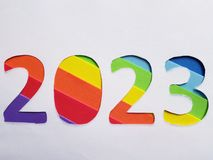 Number 2023 with foamy in rainbow colors and white background. Backdrop for ads related with multicolors, new year celebration, creative design, diversity and stock photography