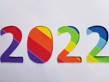 Number 2022 with foamy in rainbow colors and white background. Backdrop for ads related with multicolors, new year celebration, creative design, diversity and royalty free stock photography