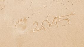The number in 2015 and footprint in the sand Royalty Free Stock Photos