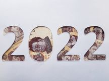 Number 2022 formed with mexican banknotes on white background. Backdrop for new year and cash announcements, date and event in calendar, economy and finance Stock Photo