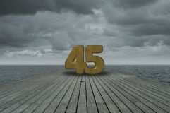 Number forty-five. On wooden floor at ocean royalty free stock photos