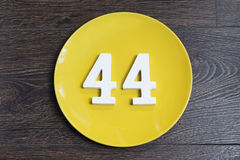 Number forty four on the yellow plate. Royalty Free Stock Photos
