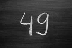 Number forty nine enumeration written with a chalk on the blackboard Royalty Free Stock Photography