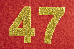 Number forty-seven yellow color over a red background. Anniversa Stock Images
