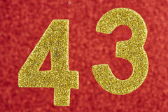 Number forty-three yellow color over a red background. Anniversa Royalty Free Stock Image