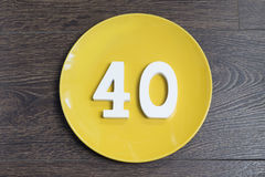 Number forty on the yellow plate. Number forty on the yellow plate and brown background Stock Photography