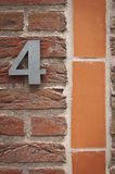 Number four on a brick wall Stock Image