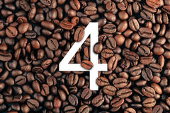 Number four on coffee bean background concept.  Royalty Free Stock Photos