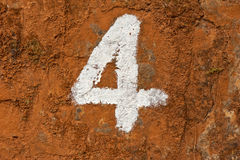 Number four on dirty wall Royalty Free Stock Images