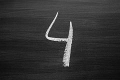Number four enumeration written with a chalk Royalty Free Stock Photo