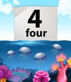 Number four and jellyfish underwater Royalty Free Stock Images