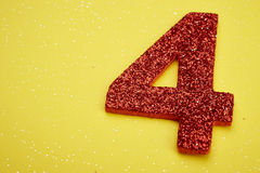 Number four red color over a yellow background. Anniversary Royalty Free Stock Photos