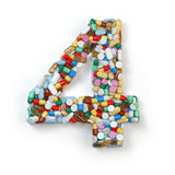Number 4 four. Set of alphabet of medicine pills, capsules Stock Images
