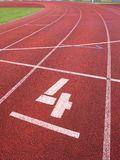 Number four. White track number on run rubber racetrack, Royalty Free Stock Images