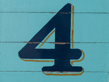 Number four on wooden wall. Number and figure Royalty Free Stock Photo