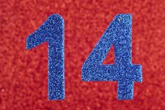 Number fourteen blue color over a red background. Anniversary. Horizontal Stock Photography