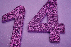 Number fourteen purple color over a purple background. Anniversa. Ry. Horizontal Royalty Free Stock Photos