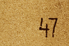 Number fourty seven on orange plaster wall. Stock Photography