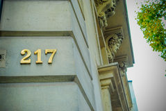Number 217 on a french building in Gold. With a tree and beautiful architecture Stock Photography