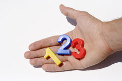 Number fridge magnets on hand Royalty Free Stock Photo