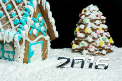 Number 2016 and gingerbread house Royalty Free Stock Photos