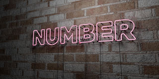 NUMBER - Glowing Neon Sign on stonework wall - 3D rendered royalty free stock illustration Royalty Free Stock Images
