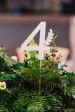 Number of guest table in petals, closeup Stock Photos
