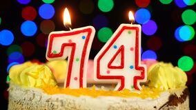 Number 74 Happy Birthday Cake Witg Burning Candles Topper.