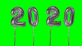 Number 2020 happy new year birthday anniversary celebration silver balloon floating on green screen background - stock video footage