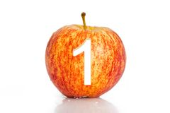 Number hole in apple isolated on white background. Royalty Free Stock Photo
