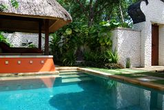A number is in a hotel. Villa with a pool. Indonesia. Bali. Novotel Benoa Stock Images