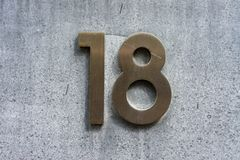House number 18. Bronze house number eighteen 18 stock photography