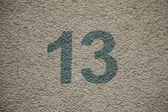 Number 13 of the house with green letters royalty free stock photography