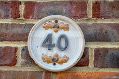 Number 40. House number plank 40 on a brick wall Stock Photo