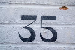 Number 35. A house number plaque with the number 35 Royalty Free Stock Photo