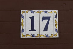Number 17. House number 17 on a red wooden wall Stock Photography