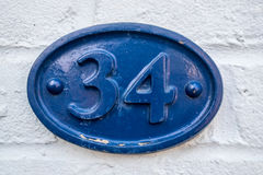 Number 34. A house sign with the number 34 Royalty Free Stock Photography
