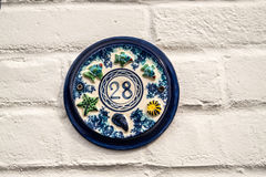 Number 28. A house sign with the number 28 Royalty Free Stock Photo