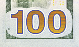 Number 100. Hundred dollars bill fragment Stock Photos