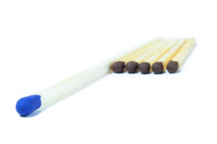 A number of identical matches and one which differ Royalty Free Stock Photo