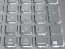 Number keys on silver keyboard of laptop Royalty Free Stock Images