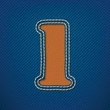 Number 1 made from leather on jeans background Stock Photography